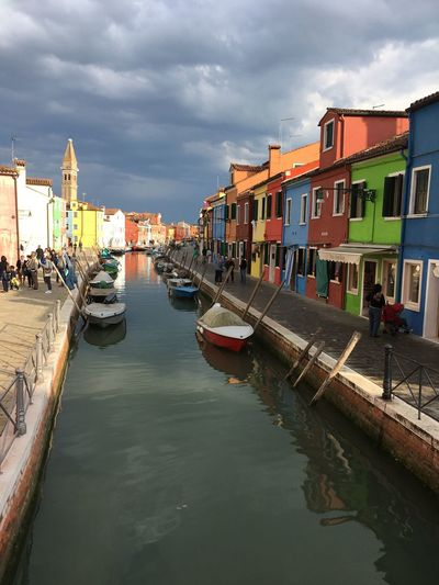 Colore Italy Colors Burano, Italy Coloured Doors Grey Sky Coloured Doors Architecture Built Structure Building Exterior Water Sky Cloud - Sky Nautical Vessel Reflection Canal Building