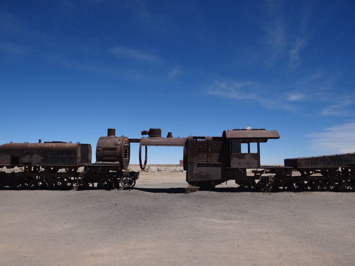 Uyuni Train Cemetry Bolivia Rust Uyuni Architecture Blue Building Exterior Built Structure Cloud - Sky Damaged Day Environment History Land Locomotive Military Mode Of Transportation Nature No People Old Outdoors Scrap Scrapyard Sky Sunlight The Past Transportation