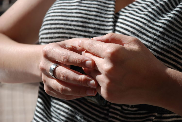 Midsection of woman wearing ring