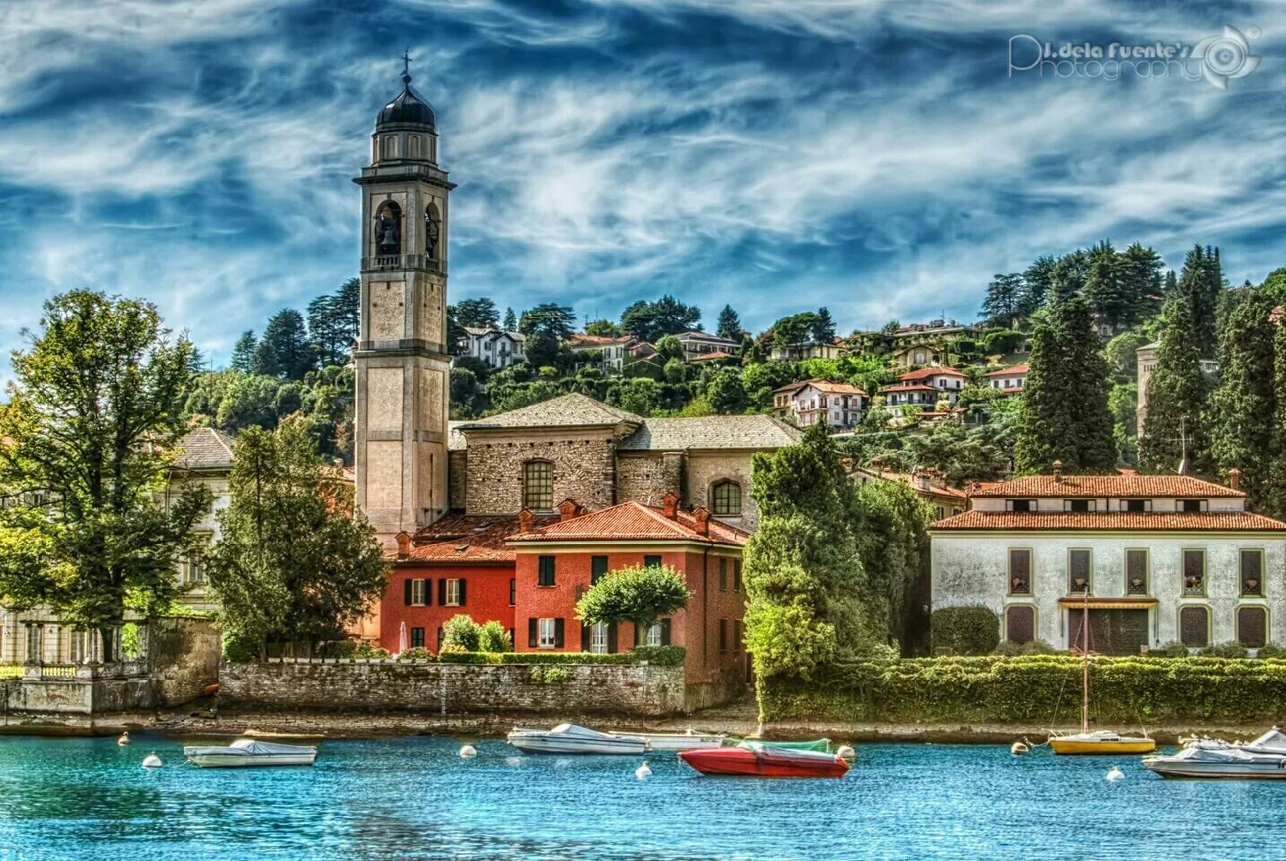 building exterior, architecture, built structure, water, tree, waterfront, sky, cloud - sky, nautical vessel, river, cloud, transportation, lake, house, boat, tower, mode of transport, cloudy, church, travel