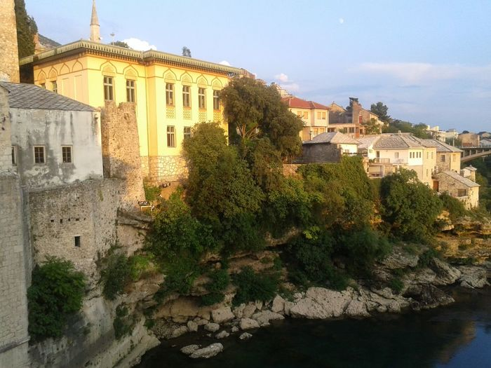 Old Bridge Mostar Bosnia And Herzegovina Tree Water House Sky Historic Civilization History Historic Building Archaeology The Past