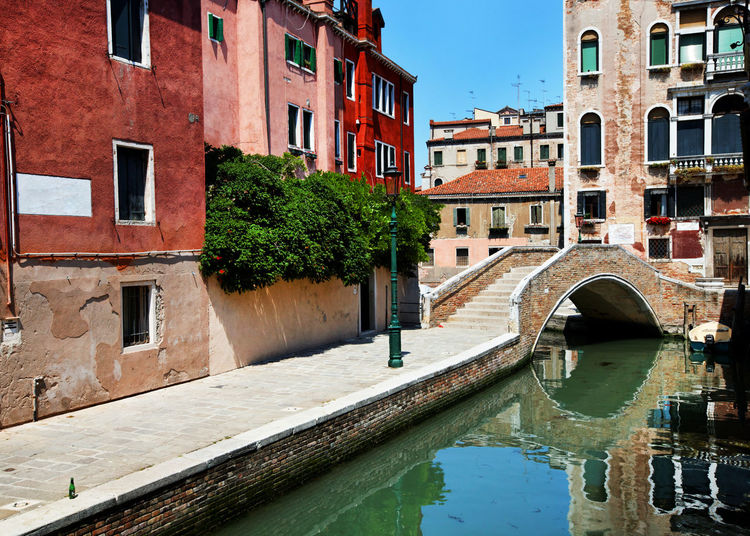 Bridge over grand canal against buildings in city