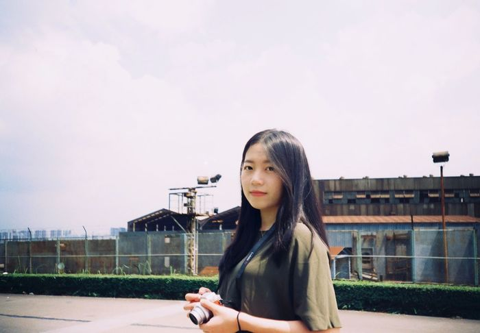 One Person Real People Built Structure Building Exterior Smiling Architecture Outdoors Sky Young Women Young Adult Casual Clothing Long Hair Portrait Looking At Camera