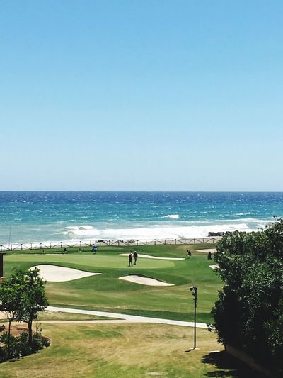 Sea Nature Clear Sky Horizon Over Water Water Beauty In Nature Copy Space Scenics Grass Beach Golf Green Color Tranquility Day Outdoors Tranquil Scene Blue Sport Tree Golf Course