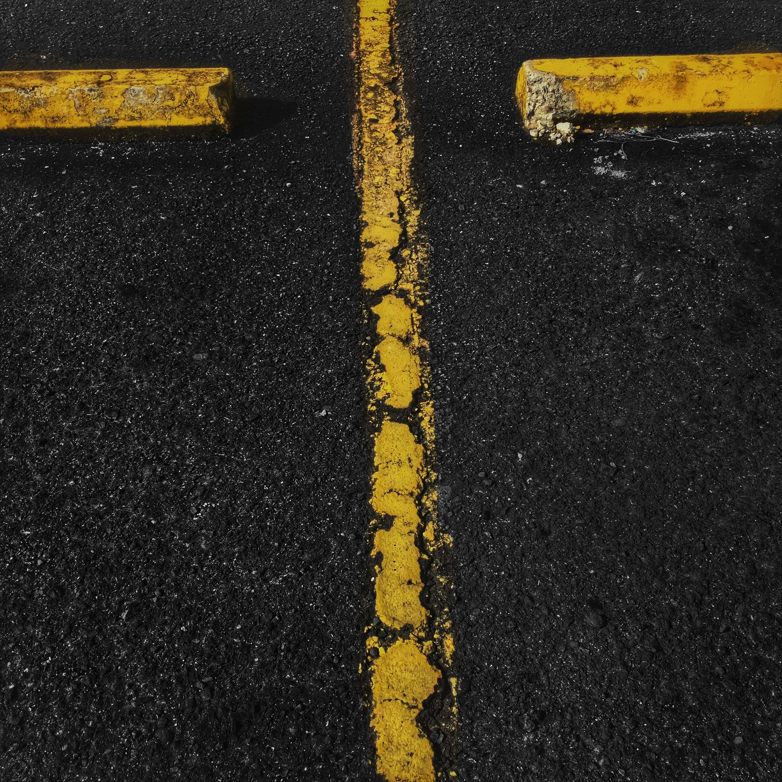 transportation, yellow, road marking, road, asphalt, street, guidance, communication, close-up, sign, road sign, direction, high angle view, car, arrow symbol, directional sign, outdoors, mode of transport, no people, text