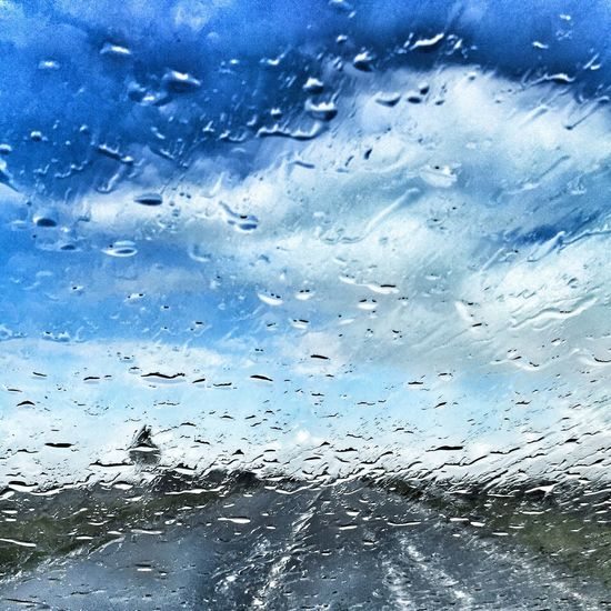 Rain Wet Window Weather Glass - Material Drop Transparent Rainy Season RainDrop Water Full Frame Backgrounds Glass No People Looking Through Window Car Sky Indoors  Day Car Interior