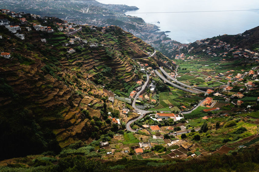 Madeira valley at south coast Drone  Madeira Madeira Island Architecture Beauty In Nature Building Building Exterior Built Structure Day Dronephotography Environment High Angle View Land Landscape Mountain Nature No People Outdoors Plant Road Scenics - Nature Tranquil Scene Tranquility Tree Valley