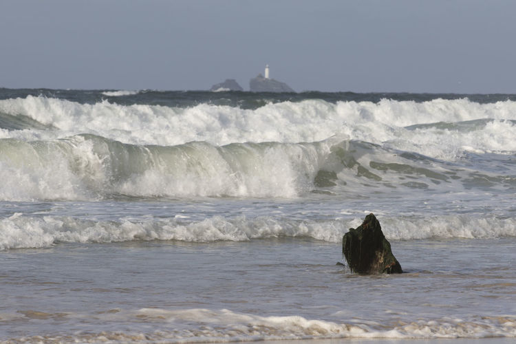 Lighthouse Pounding  Power Of Nature Rough Sea Beach Breaking Cornwall Day Driftwood Godrevy Lighthouse Horizon Over Water Motion Nature Outdoors Power In Nature Rollingwaves Sea Water