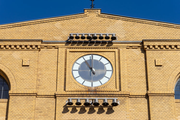 Low angle view of clock tower against building