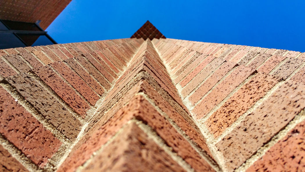 Architecture Brick Wall Building Exterior Built Structure Clear Sky Day Lines Low Angle View No People Outdoors Pattern Sunlight Symmetry