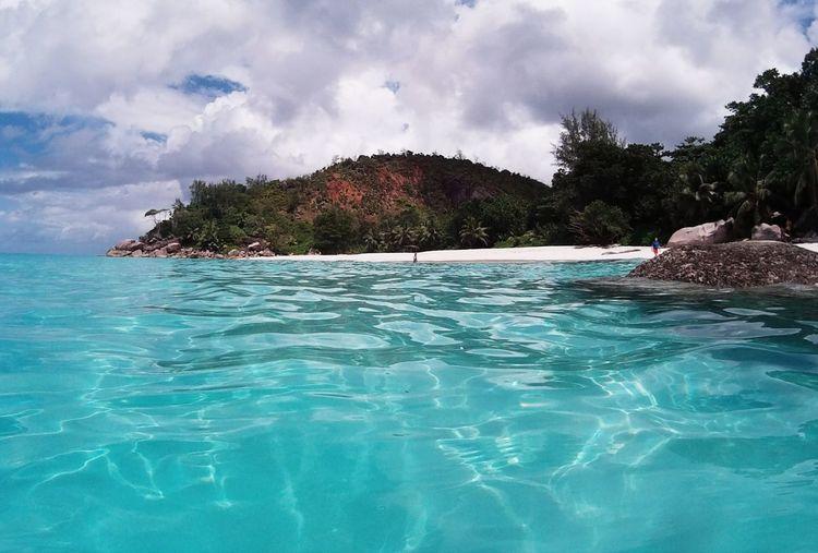 Water Tropical Climate Cloud - Sky Sea Travel Destinations Beach From The Sea Idyllic Seychellesisland Solitude Scenics Island Paradise Seychelles Islands Seychelles Seychellen Nature Anse Georgette Praslin Praslin Seychelles