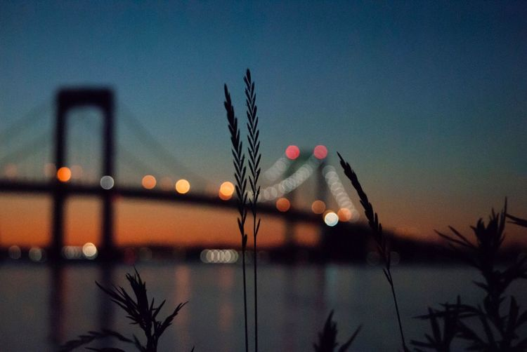 Sunset First Eyeem Photo Sky Architecture Sunset Illuminated Built Structure Dusk No People Nature Beauty In Nature City Water Silhouette Night Focus On Foreground