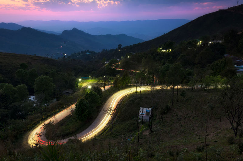 High angle view of road against sky at night