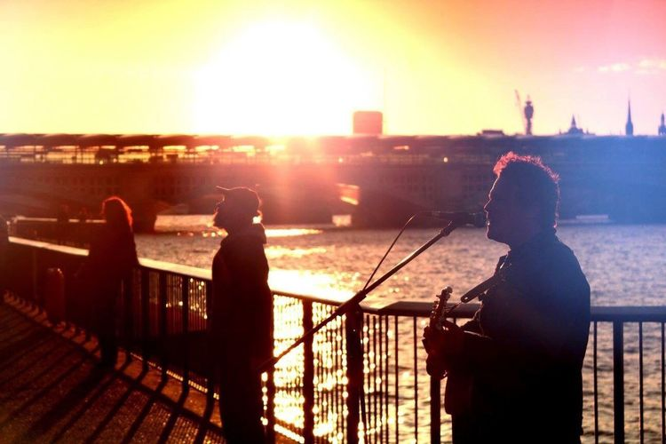 London Lifestyle Sunset One Person Sunlight Lens Flare Railing Music City Standing Rear View Silhouette Adults Only Outdoors One Woman Only People Adult Performance Cityscape Sky Architecture Musician
