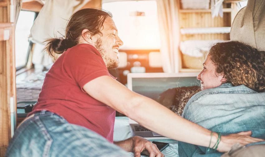 Smiling couple relaxing in van