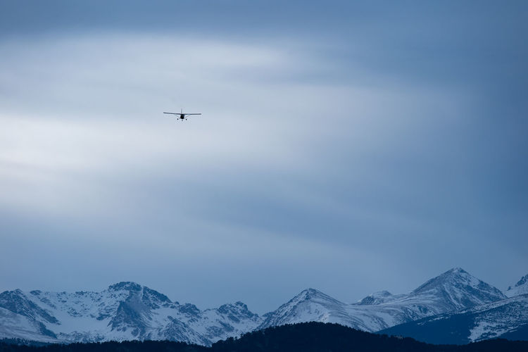 Colorado Boulder Nature Mountain Air Vehicle Sky Flying Airplane Transportation Mode Of Transportation Cold Temperature Beauty In Nature Scenics - Nature Snow Winter Mountain Range Mid-air Cloud - Sky No People Snowcapped Mountain Day Outdoors Plane
