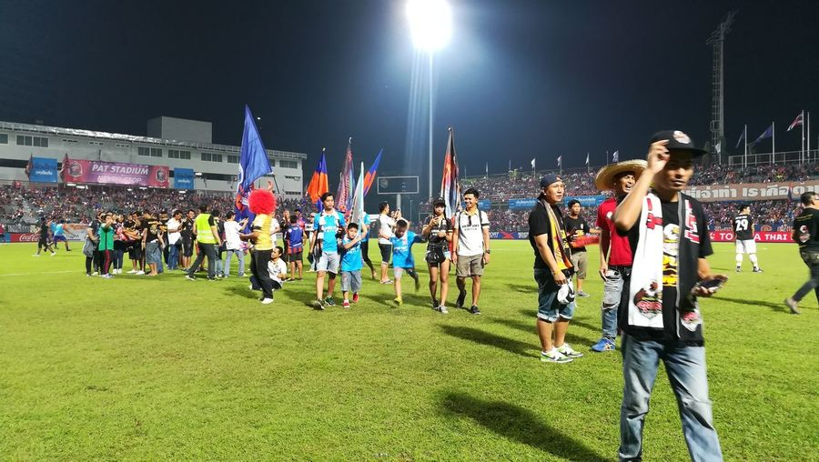 People on field against sky at night