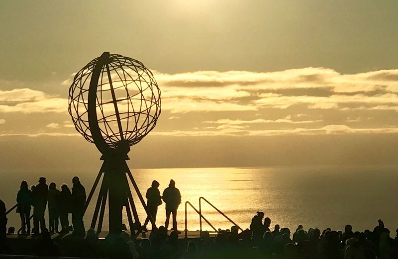 Nordkap Sunset Sky Silhouette Group Of People Water Men Lifestyles Orange Color Nature Leisure Activity Beauty In Nature Basketball - Sport People Real People Playing Sport Sun Togetherness Cloud - Sky Outdoors