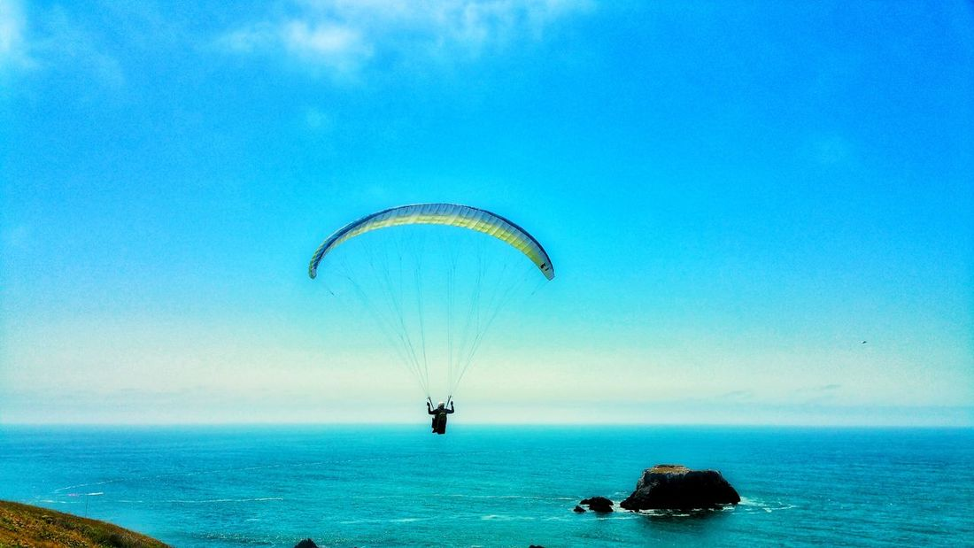 Paragliding over the sea.What a glorious day! Background Blue Sky Zen Meditation Timeless Moment Copy Space Distance Red Passion Sport Dangerous Adventure Thrill Seeker UnderSea Parachute Paragliding Extreme Sports Sea Adventure Water Blue Beach Flying Horizon Over Water Coast Calm Seascape Ocean