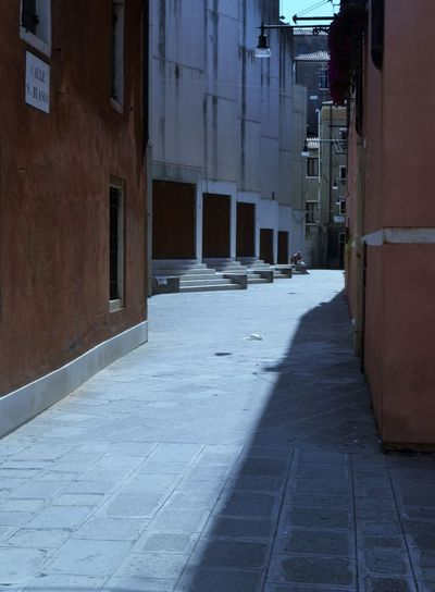 Tranquility Alley Architecture Building Building Exterior Built Structure Day Light And Shadow No People Outdoors Symmetry The Way Forward Travel Destinations Walkway