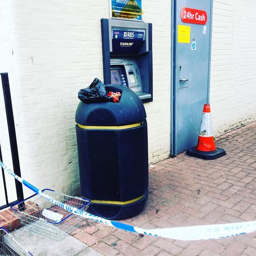 Vandalised cash point at Tesco Express in Milford, Surrey. Thieves failed in their attempt to use an angle grinder to break into the ATM. Thief Thieves Robber Robbery Robbery. Cash Point Atm Machine Tesco  Tesco Express Vandal Vandalism Milford Surrey England England🇬🇧