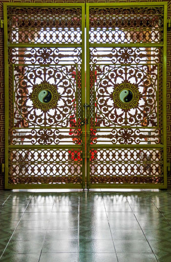 Ornate metal gate at Viharn Sien Temple in Pattaya, Thailand Viharnra Sien Viharn Sien Asian  Entrance Gate Pattaya Security Taoism Thailand Tourist Attraction Chinese Culture Destination Door Doorway Metal Museum Oriental Protection Temple Tourism Vacation Visit Yinyang