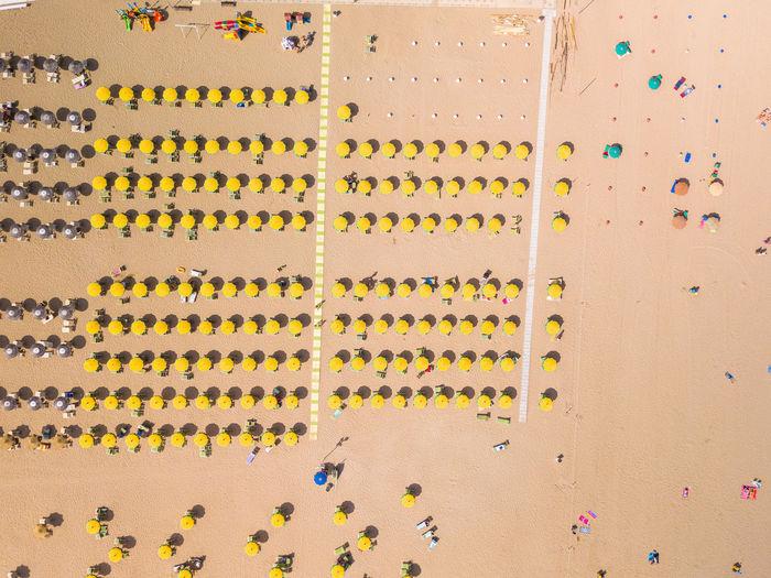 Multi colored umbrellas on sand