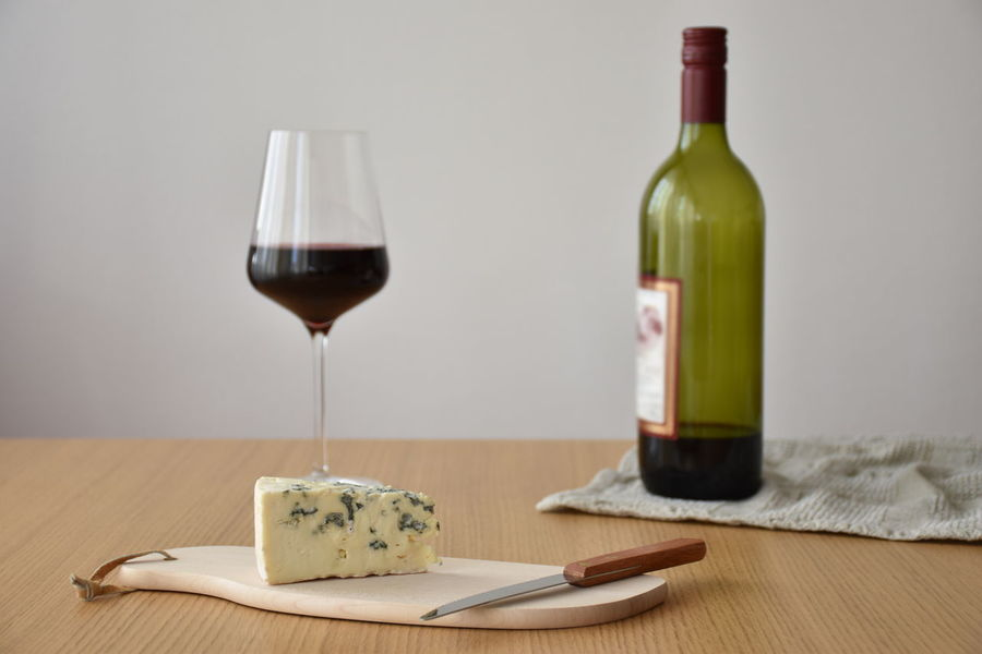 Knife Alcohol Bottle Cheese Close-up Cutting Board Drink Drinking Glass Food Food And Drink Indoors  No People Red Wine Table Wine Wine Bottle Wineglass
