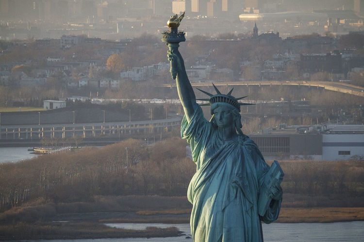 Statue of liberty with city in background