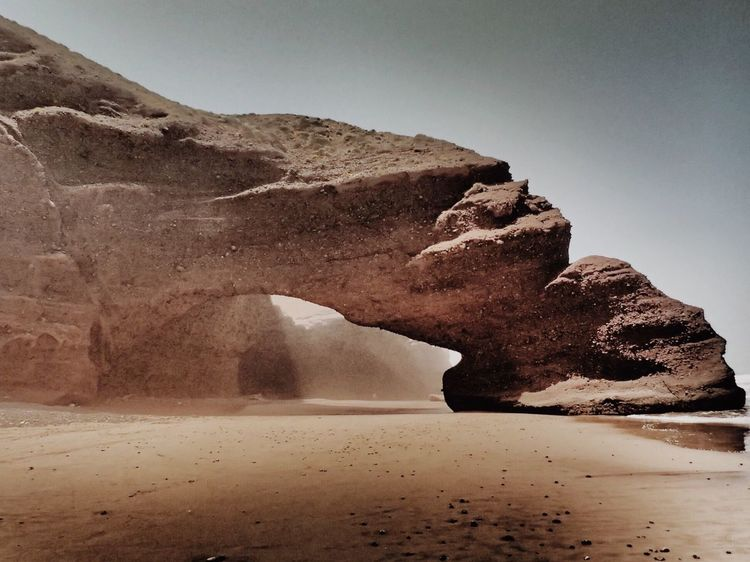 Rock Formation Geology Rock - Object Nature Sand Beauty In Nature Scenics Tranquility Tranquil Scene Physical Geography Landscape Non-urban Scene Natural Arch Desert Arid Climate Beach Mountain Outdoors Sky Legzira Legzira Stone Arches AMPt_community IPhoneography EyeEm Gallery Sommergefühle Lost In The Landscape Connected By Travel