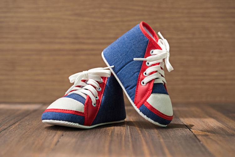 Close-up of canvas shoes on wooden floor
