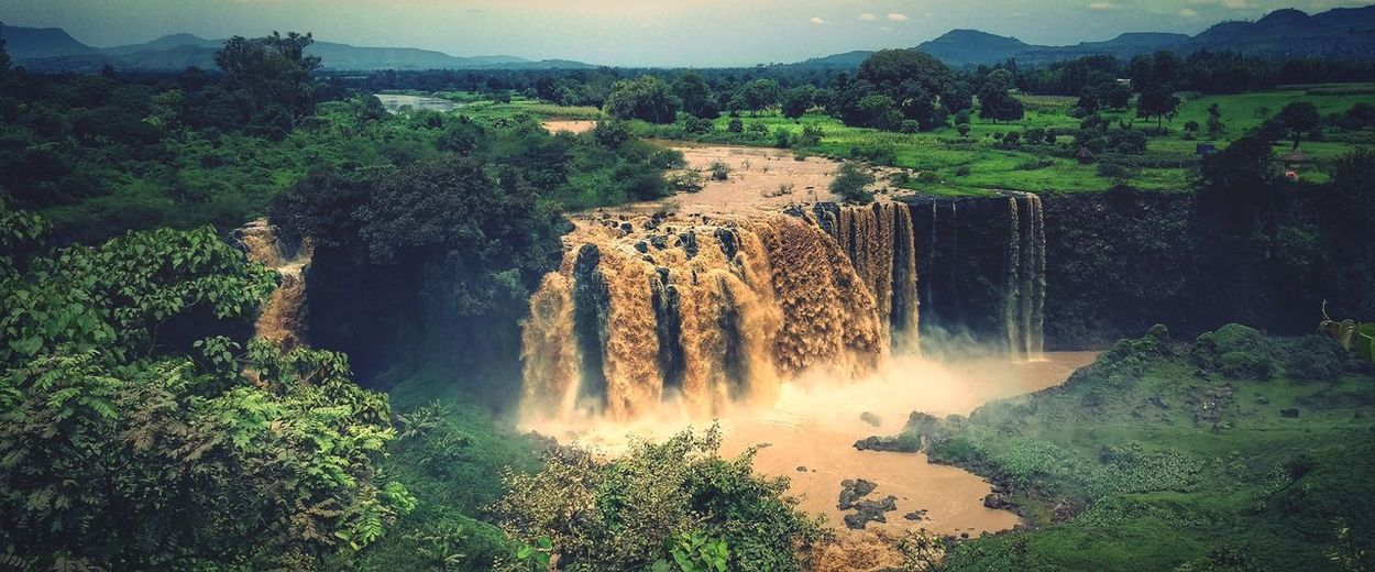Tis Abay Tis Esat falls at the rainy season Bahirdar Ethiopia Water Motion Waterfall Long Exposure Outdoors Tree Nature No People Scenics Spraying Beauty In Nature Mountain Day Irrigation Equipment Sky