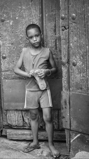 Child One Person Portrait Sadness Childhood Elementary Age Streetphotography Front View Full Length Standing Child Poverty Flipflops Staring Blackandwhite Real People Lifestyles Boy EyeEm Best Shots Tears Sadeyes