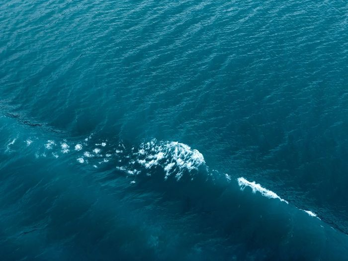 High angle view of waves in sea