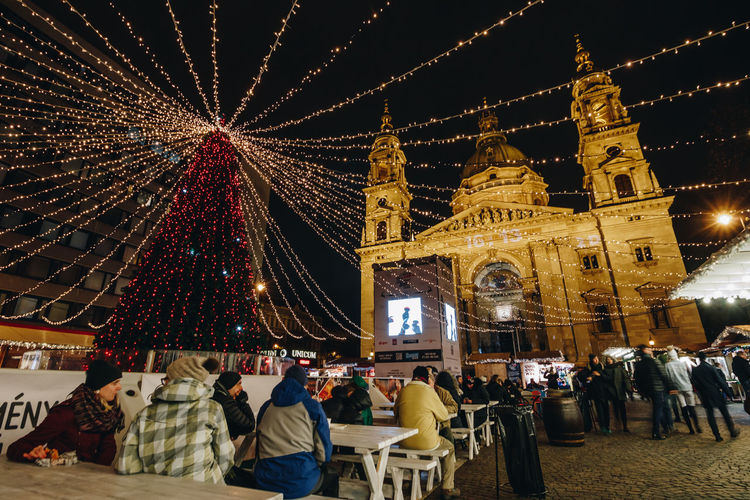 Budapest Christmas Fair Architecture Building Exterior Built Structure Celebration Christman City Illuminated Large Group Of People Leisure Activity Lifestyles Men Night Outdoors People Place Of Worship Real People Religion Sky Spirituality Travel Destinations Women