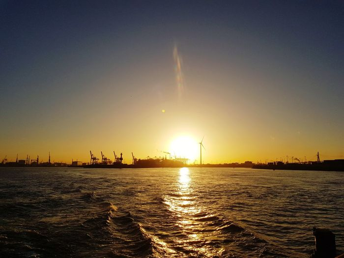 Sunset Water Sky Outdoors No People Travel Destinations Beauty In Nature Nature Refraction Sun Sunlight City Scenics Sea Tranquility Day Hamburger Hafen Hamburg Harbour Hamburger Hamburg Harbor Oil Industry