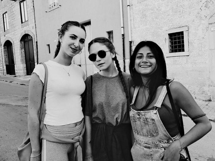 Building Exterior Built Structure Real People Leisure Activity Portrait Looking At Camera Architecture Outdoors Smiling Togetherness Casual Clothing Happiness Day Standing Bonding Friendship Young Women Young Adult Lifestyles Arm Around Blackandwhite EyeEm Selects EyeEmNewHere Friends