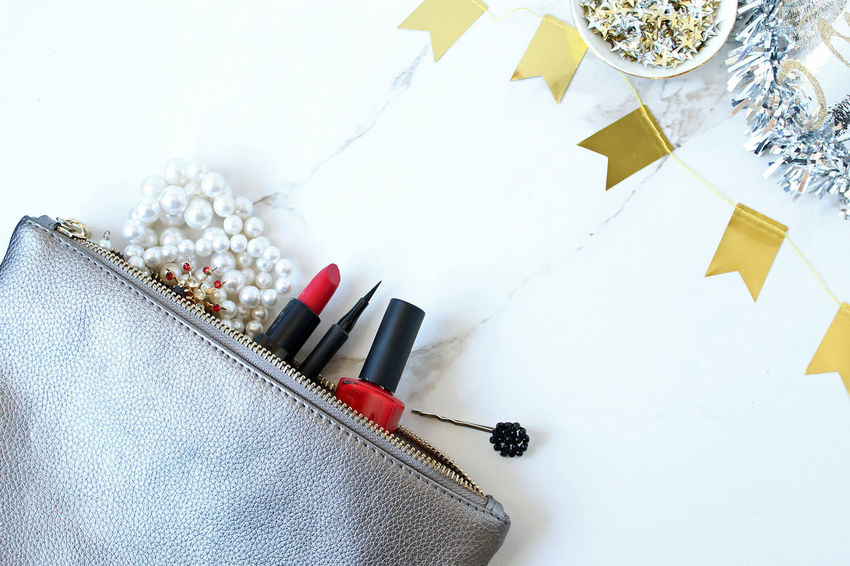 Beauty Cosmetics Eyeliner Fashion Flat Lay Frame Glamour Make Up Make Up Bag Overhead View Pearls Purse Red Lipstick Red Nail Polish Rhinestones Vintage