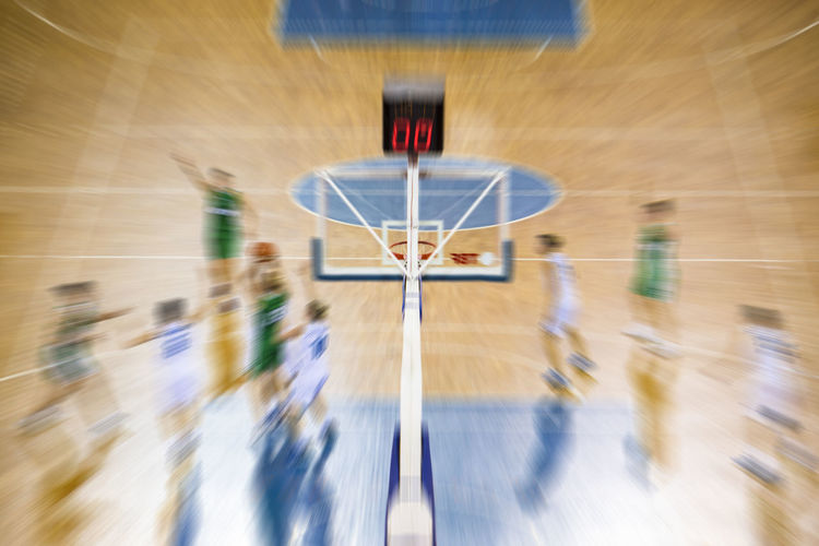 Blurred Motion Of Players Playing Basketball