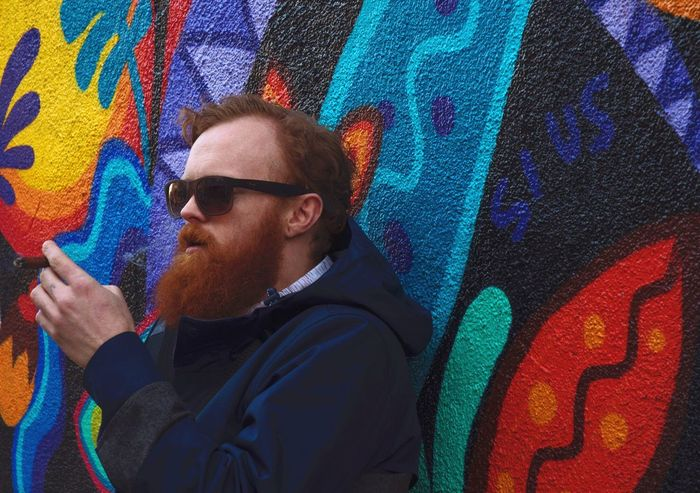 Somewhat hipster I guess Graffiti Wall - Building Feature Street Art One Person Multi Colored Spray Paint Sunglasses Real People Lifestyles Young Adult Waist Up Outdoors Cool Attitude Standing Portrait Front View Leisure Activity Young Men Cool Headshot Nikonphotography The Portraitist - 2017 EyeEm Awards EyeEmNewHere