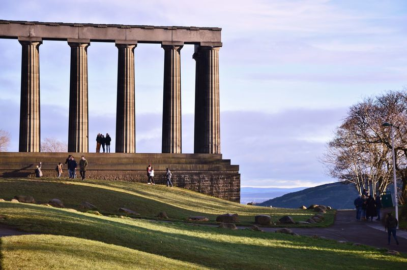 Calton Hill Edinburgh Scotland Ancient Civilization Architecture Built Structure Day Grass History Large Group Of People Lifestyles Men Nature Outdoors People Real People Sky Travel Destinations