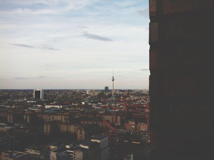 Cityscape against cloudy sky