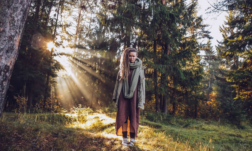 Young woman with dreadlocks in autumn fall forest in the morning sunshine Fall Fall Forest Autumn colors Autumn Collection Dreadslocks Dreadhead Outdoors Nature Forest Tree Boho Happiness Boho Style