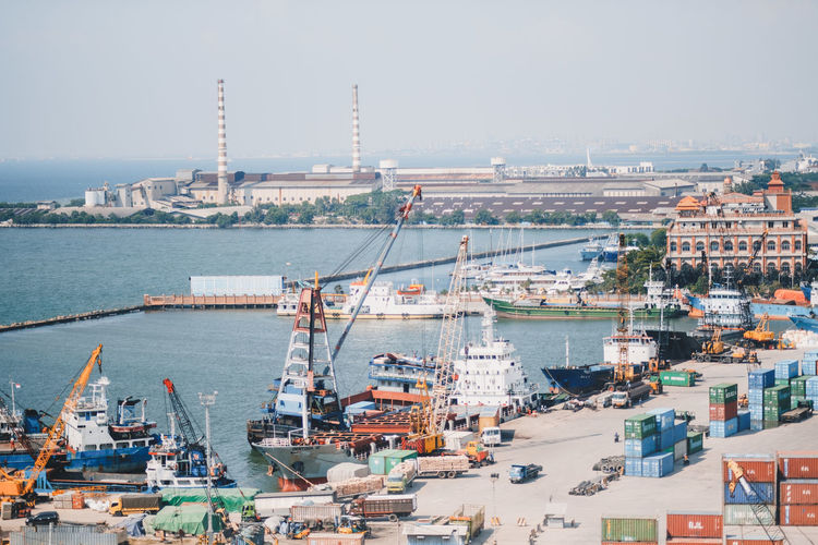 Water Transportation Nautical Vessel Industry Architecture Sea Cargo Container Container Commercial Dock Machinery Freight Transportation Harbor Shipping  Crane - Construction Machinery Pier Mode Of Transportation Ship Industrial Ship Business Building Exterior Outdoors No People Sailboat Cityscape