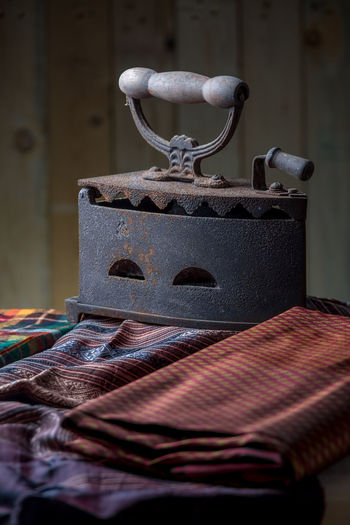 Close-Up Of Old Rusty Iron On Clothes