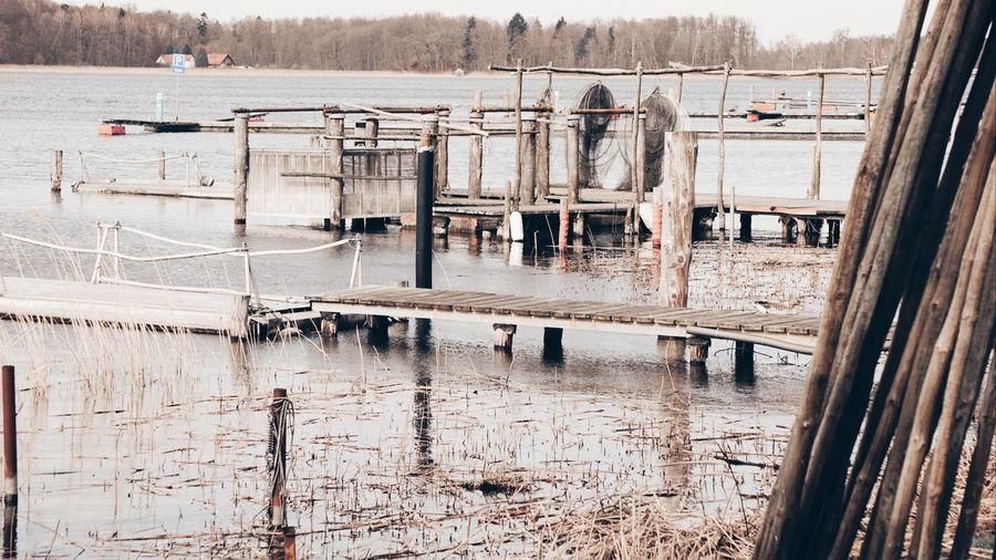 Pier on lake during winter