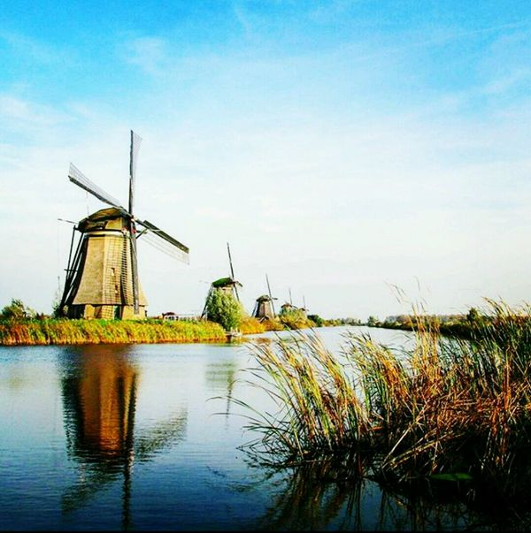 Mill Nature Built Structure Windmill Rural Scene Water Architecture Outdoors No People Environmental Conservation Lake Sky Day Factory Grass Watermill The Great Outdoors - 2017 EyeEm Awards