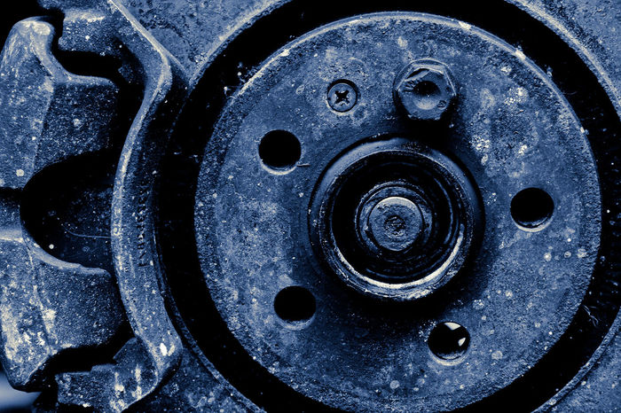 close up image of car disc break background texture Automobile Auto Auto Repair Shop Automobile Industry Automobile Parts Automobile Photography Automotive Car Close-up Day Disc Brakes Disc Break Garage Gear Industry Machinery Maintenance Metal No People Repair