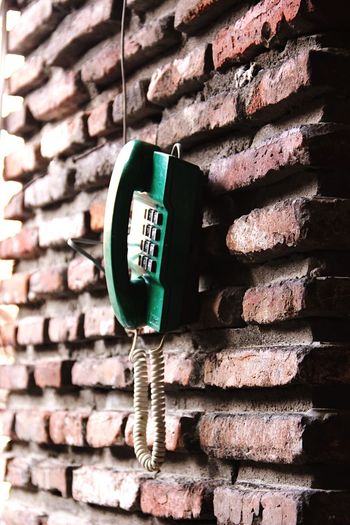 Landline phone hanging against wall