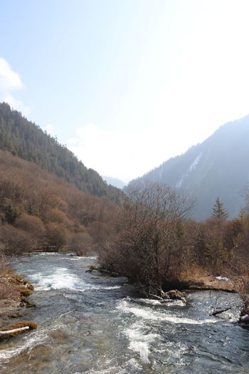 Scenic view of river against sky during winter